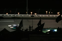Daytona fans watch the race at night