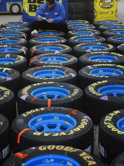 Penske crewman preps Ryan Newman's tires