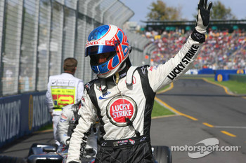 Pole winner Jenson Button celebrates