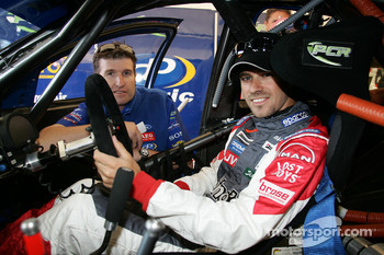 Tiago Monteiro sits in an Australian V8 car with Paul Cruickshank of PCR Racing