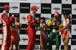 Podium: race winner Sébastien Bourdais with Justin Wilson and Alex Tagliani