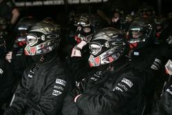 Midland F1 Racing team members watch the race