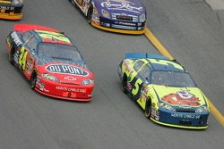 Kyle Busch and Jeff Gordon battle for the lead