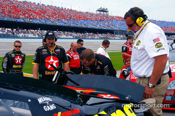 A race official conducts his pre-qualification inspection