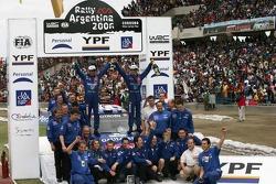 Podium: winners Sébastien Loeb and Daniel Elena celebrate with their team