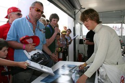 Sebastian Vettel signs autographs