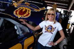 Actress Jaime Pressly and NASCAR fan checks out the #26 Crown Royal Ford car in the garage