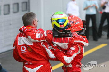 Race winner Michael Schumacher celebrates with Ross Brawn and Felipe Massa
