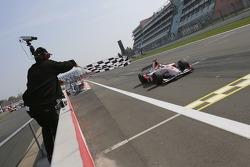 Lewis Hamilton takes the checkered flag to win