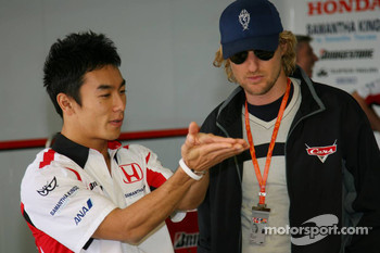 Takuma Sato and actor Owen Wilson promoting new animated film