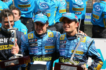 Race winner Fernando Alonso celebrates with Giancarlo Fisichella and Renault F1 team members