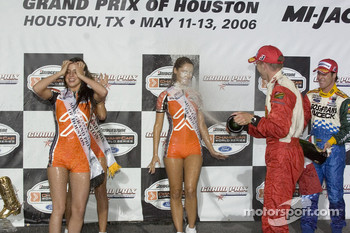 Podium: Sbastien Bourdais and Mario Dominguez spray champagne on the Champ Car girls