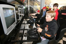 Young fans enjoy a racing sim