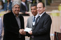 Charity football match: Prince Albert II of Monaco gives a cheque to the charity supporting the football match