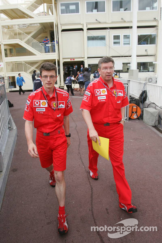 Chris Dyer and Ross Brawn leave the stewards building after a meeting regarding Michael Schumacher's pole position