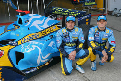 Fernando Alonso and Giancarlo Fisichella pose with new livery designed by Taiwanese design studio DEM
