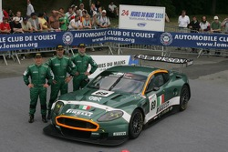 Fabio Babini, Christian Pescatori, and Fabrizio Gollin pose with the BMS Scuderia Italia Aston Martin DBR9