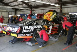 The crew works on the car of Martin Truex Jr.