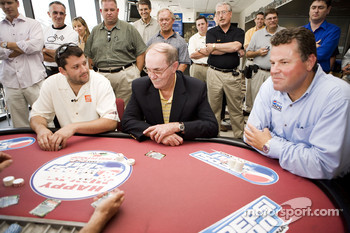 Tony Stewart talks poker with NASCAR Vice President of Corporate Communications Jim Hunter and Daytona International Speedway President Robin Braig