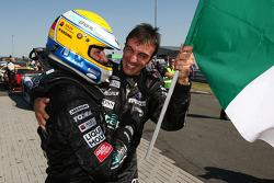 Race winners Michael Bartels and Andrea Bertolini celebrate