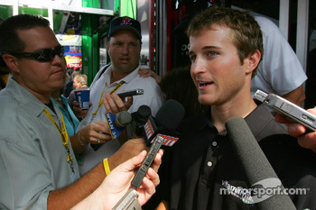 Kasey Kahne responds to questions from the media in front of his hauler