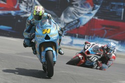 Chris Vermeulen being chased by Kenny Roberts