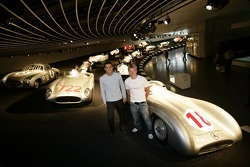 DaimlerChrysler Mercedes media warmup event: Pedro de la Rosa and Kimi Raikkonen stand in front of historical silver arrows at the Mercedes-Benz branch in Stuttgart