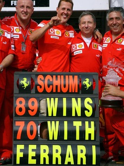 Race winner Michael Schumacher celebrates with this team