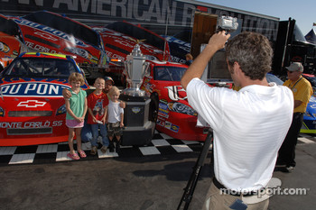 Young fans poses with the Allstate 400 at the Brickyard trophy