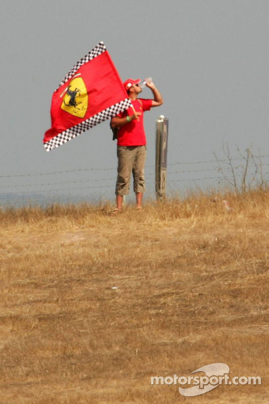 A Ferrari fan quenches his thurst