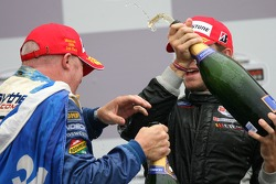 Podium: champagne for Paul Tracy and Nelson Philippe