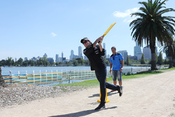 Sergio Perez, Sahara Force India F1 Team, plays cricket in Albert Park with Brad Hodge, International Cricket Player