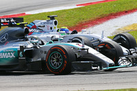 Nico Rosberg, Mercedes AMG F1 W06 and Felipe Massa, Williams FW37 battle for position