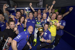 Race winner Valentino Rossi celebrates with his team