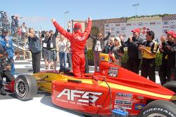Victory lane: Alex Lloyd celebrates