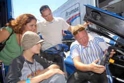 Rob Finlay and Michael Valiante show workings of their car to Selma and David Granado from Make-A-Wish
