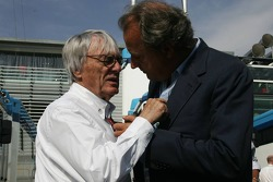 Bernie Ecclestone and Angelo Codignoni, Eurosport president and CEO