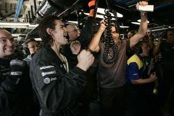 McLaren team members celebrate as Kimi Raikkonen takes the pole