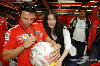 Loris Capirossi signs autographs