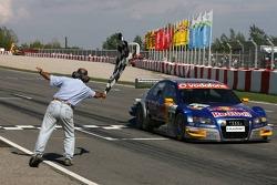 Martin Tomczyk takes the checkered flag