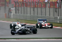Nico Rosberg leads Robert Kubica and Jarno Trulli