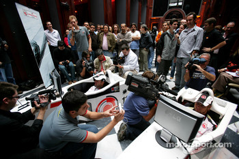 Lucky Strike PR day: Jenson Button and Rubens Barrichello entertain the crowd on a simulator