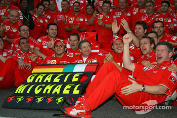 Michael Schumacher celebrates his retirement with Ferrari team members
