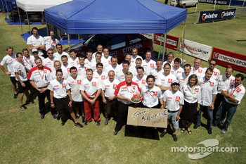 Kronos Total Citroen team members celebrate the birthday of Daniel Sordo