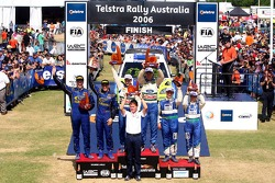 Podium: winners Mikko Hirvonen and Jarmo Lehtinen, with second place Petter Solberg and Phil Mills, and third place Manfred Stohl and Ilka Minor