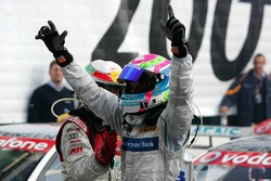 Race winner Bruno Spengler celebrates with Tom Kristensen