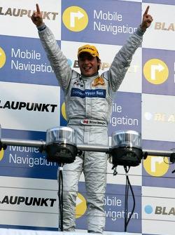 Podium: race winner Bruno Spengler celebrates
