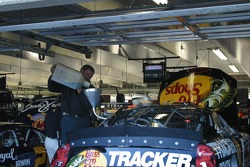 A crew member puts racing fuel in Martin Truex's car