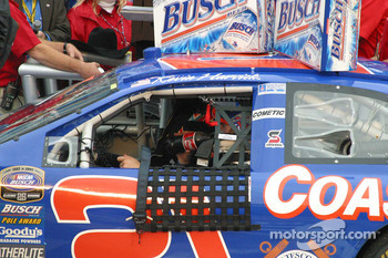 Kevin Harvick sits in the car in victory lane
