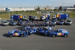 Volkswagen Motorsport drivers and co-drivers pose with Volkswagen Motorsport team members in Lisbon